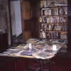 """The welcome table and books in Baldwin's """"last room,"""" an upstairs living room that was transformed into his bedroom during the final few months of his life."""