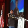 Sergeant Major Christal Rheams of the U.S. Army Band opens the evening with the national anthem.