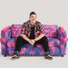 Brian Lanigan models the Bisexual Flag Couch