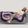 Brianna Roye models the Asexual Flag Couch