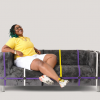Marisa Rosa Grant models the Nonbinary Flag Couch