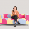 Sarah Bellstedt models the Pansexual Flag Couch