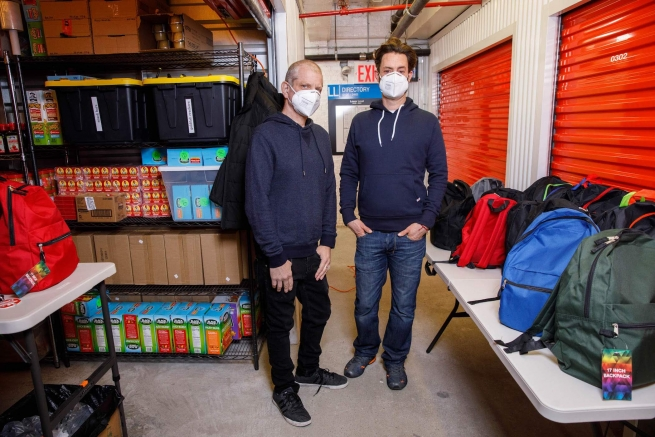 gay couple supplies backpacks full of COVID supplies to homeless populations