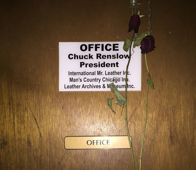 The office of the big guy, with a memorial rose or two