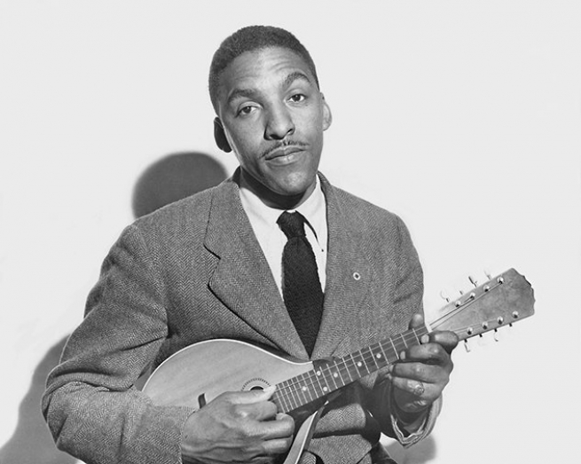 Posing with the lute he taught himself to play while incarcerated as a conscientious objector, 1947. Courtesy Bayard Rustin Estate.