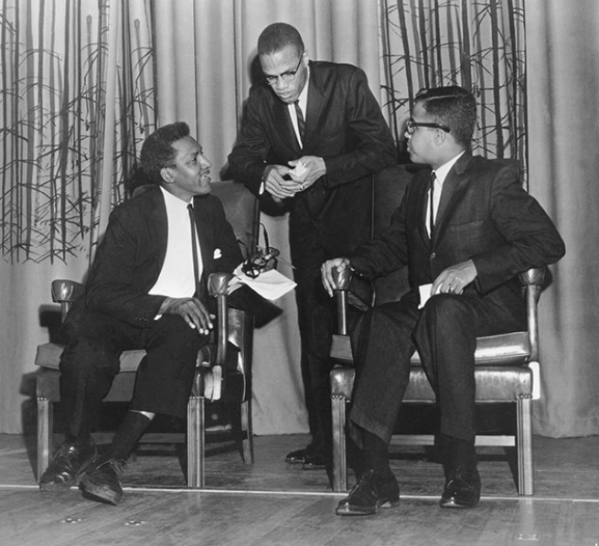 Taking a break with Malcolm X and debate moderator Michael R. Winston at Howard University, October 1961. Courtesy Moorland-Spingarn Research Center, Howard University Archives.