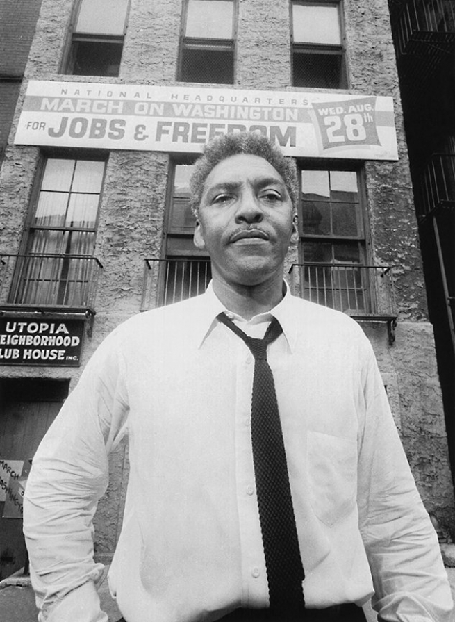 With the March on Washington less than a month away, Rustin poses in front of the National Headquarters office on West 130th Street, New York City, August 1, 1963. Photo: Associated Press/Wide World.