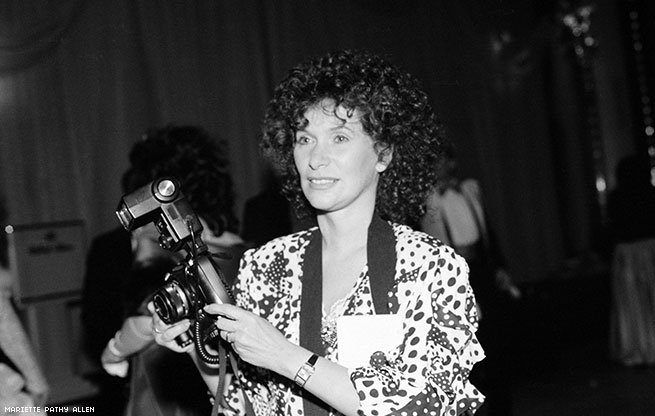 Photograph of Mariette Pathy Allen at work at a conference, 1991. Courtesy of Mariette Pathy Allen.