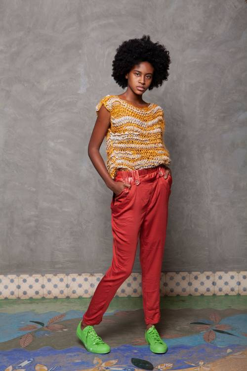Woman wearing knit top and red pants, the top from WeDu by Coreon Du is made from fabric remnants